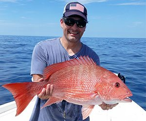 Man Holding Snapper